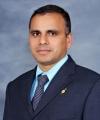 Dr. Madan Kharel